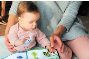 Infant with book