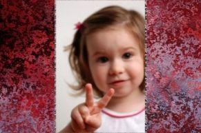 toddler holding 2 fingers